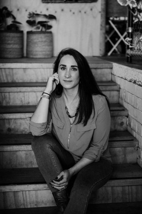 Alice Heydon luxury wedding planner sitting on steps at Stackwood Fremantle