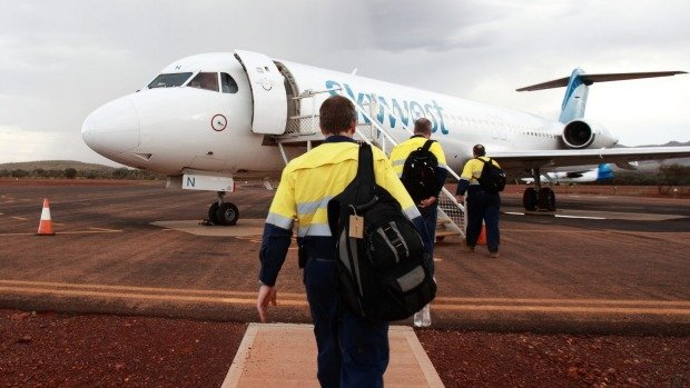 fifo worker plane hi vis going to work Perth
